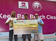 the guys with giant $8,000 cheque